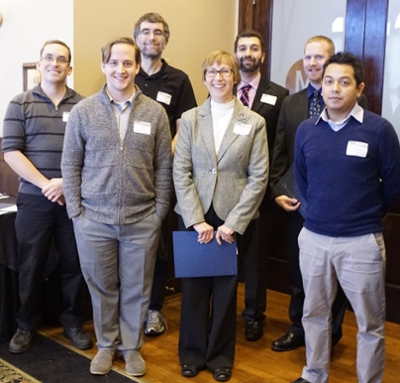 northwestern information technology it senior distributed support specialist brian suarez pictured second from left was selected in december as